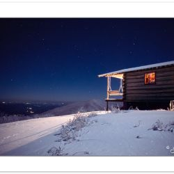 W00169:  Mountain cabin at night with porch light on, NC-TN stat